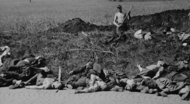 German speaking East Europeans digging their own graves before execution, following defeat of Nazism in 1945