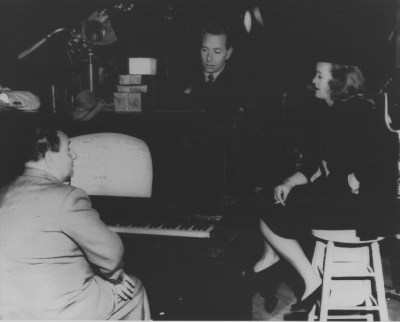 Korngold rehearsing with Bette Davis and Paul Henreid